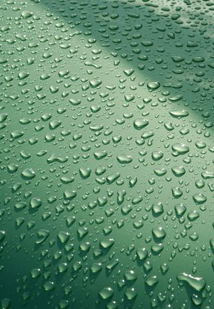background of raindrops on a green vehicle panel photo