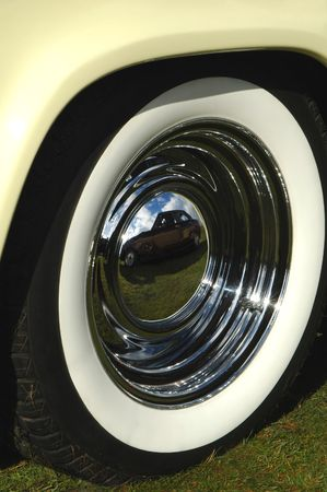 hubcaps: reflections off a vintage car chrome hub Stock Photo