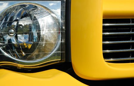 pickups: pick-up truck light and grill abstract