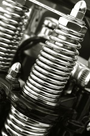 chromed motorcycle suspension springs close-up Stock Photo