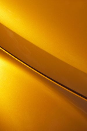golden glitter curved vehicle panel abstract photo
