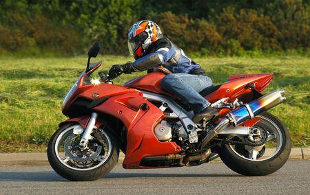 motor bikes: motorcycle rider cornering at speed Stock Photo