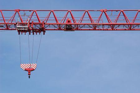 construction crane jib against blue sky photo