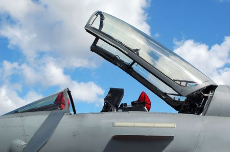 unmarked: open canopy of an unmarked military jet