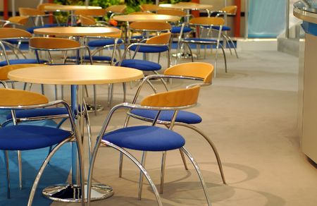 empty cafeteria with wooden tables and chrome chairs
