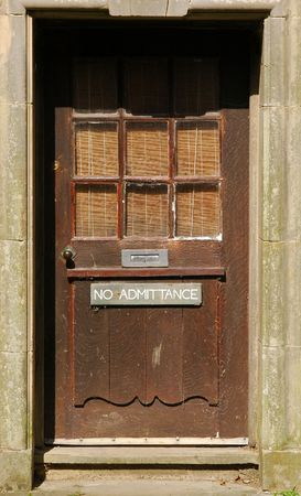 no admittance sign on a battered old door photo