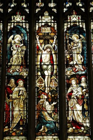 crucify: crucifixion of jesus on an elizabethan stained glass window Stock Photo
