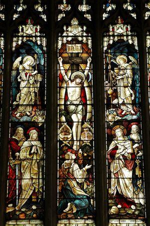 elizabethan: crucifixion of jesus on an elizabethan stained glass window Stock Photo