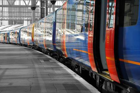 commuter train on an empty station platform