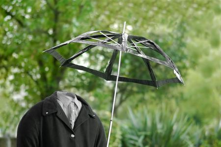 invisible man out for a walk in the rain Stock Photo