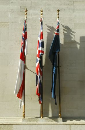 wartime: british flags of remembrance on a wartime memorial Editorial