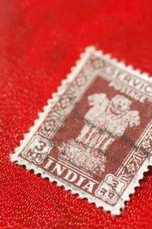indian postal stamp: vintage Indian postage stamp on a red background