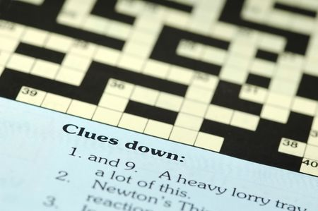 clues: crossword puzzle closeup with clues down