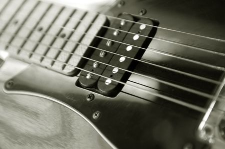 strat: vintage electric guitar close-up with narrow d.o.f. Stock Photo