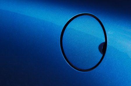 mpg: metallic blue vehicle fuel filler cap