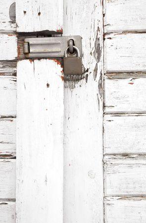 padlocked: padlocked old white wooden gateway