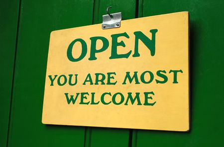 friendliness: polite old welcome sign hanging in a doorway
