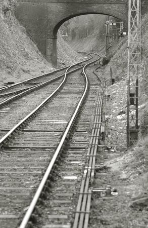 single track: vintage railroad merging from double to single track