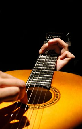 vibrations: musician playing a spanish style guitar