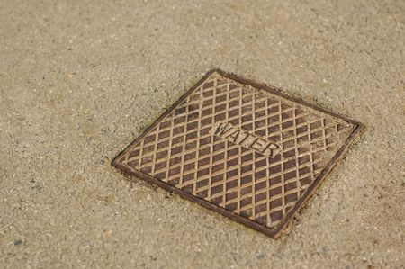 close-up of a water utility drain cover photo
