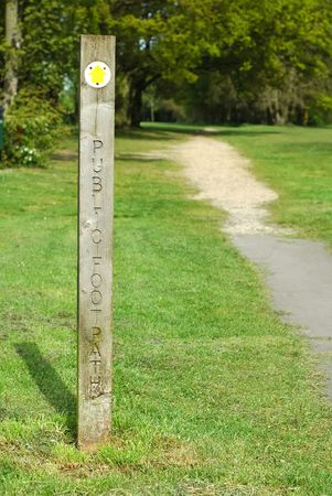 right path: public foot path direction sign into woodland