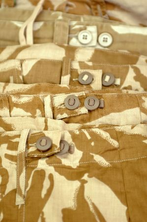 fatigues: beige military desert camouflage clothing Stock Photo
