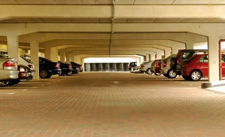 numerous: numerous vehicles parked in an underground car park Editorial