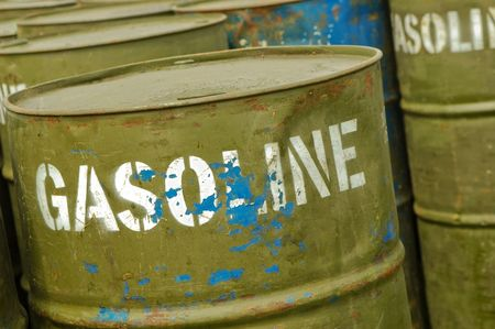 store of well used gasoline fuel drums photo