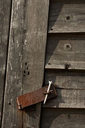 wooden out-house secured only by a golf tee photo
