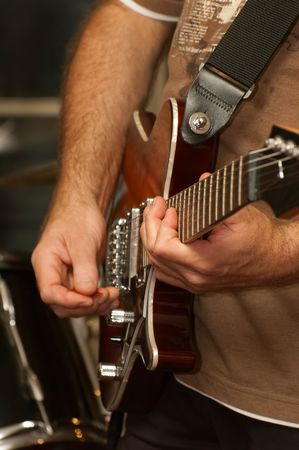jamming: musician playing electric guitar during a live performance Stock Photo