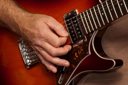 live performance: closeup of guitarists hand during a live performance