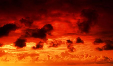 flaming red fire in the sky cloudscape background photo