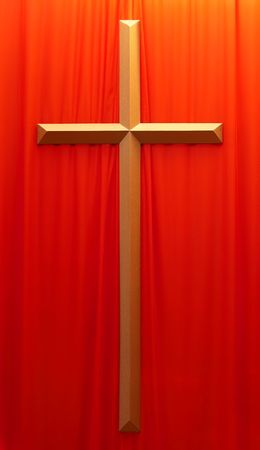 forgiving: golden crucifix on a red fabric background Stock Photo