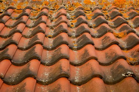 background of interlocking red clay roofing tiles photo