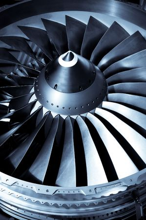 close-up of jet engine turbine blades photo