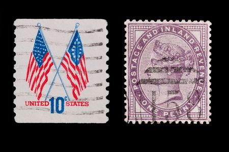 vintage U.S and Victorian stamps on black Stock Photo - 5980797