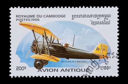 cambodian aviation mail stamp featuring the Pitcairn PA-5 bi-plane photo