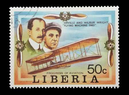 brothers: liberian mail stamp celebrating the wright brothers first flight  Editorial