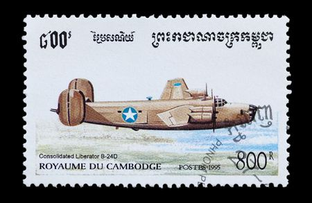 bomber: mail stamp printed in Cambodia featuring a USAF Liberator B 24D bomber aircraft Stock Photo