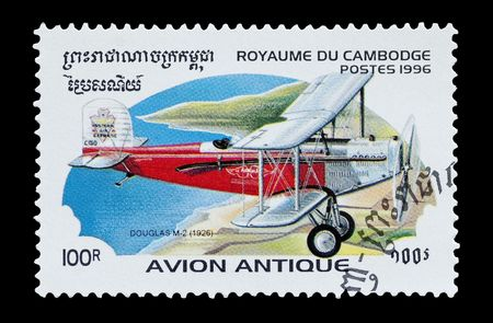 mail stamp printed in Cambodia featuring a Douglas M2 biplane Stock Photo - 6595486