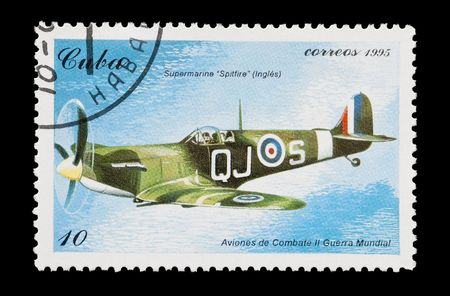mail stamp printed in Cuba featuring an RAF Spitfire fighter aircraft Stock Photo - 6595490