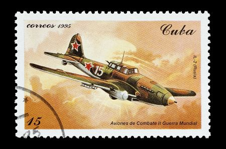 mail stamp printed in Cuba featuring a WW2 Ilyushin IL-2 fighter aircraft photo