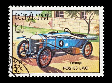 mail stamp printed in Laos featuring a vintage Delage sports car Stock Photo - 6631085