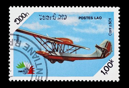 cant: mail stamp printed in Laos featuring a Cant 501 seaplane