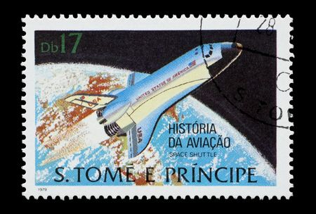 mail stamp printed in Africa featuring the Space Shuttle orbiting the Earth photo
