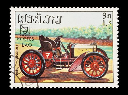 mail stamp printed in Laos featuring a vintage Daimler sports car Stock Photo - 6655357