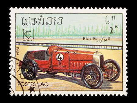 mail stamp printed in Laos featuring a vintage Fiat S57 sports car Stock Photo - 6655359