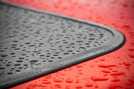 abstract of raindrops around a vehicle window seal photo