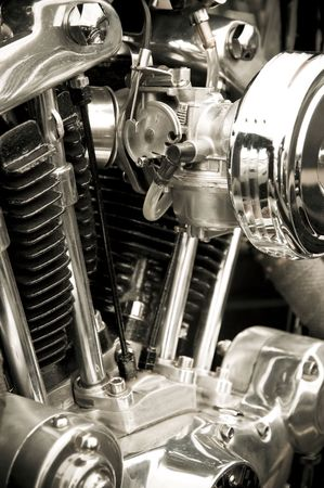 chromed detail and cyclinders of a powerful motorcycle engine photo
