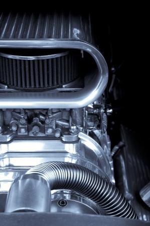 drag: chromed engine supercharger on a performance race car